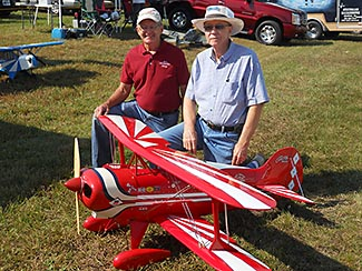 George Bassett on the left and Bob Bailey on the right with George's Pitts that Bob built in 1976. Bob flew the plane a few times and then sold it to Cliff Bennett of B&B Specialties.  Cliff had a bad cross wind crash and George bought the plane from Cliff and put it back in flying condition.  It was great to get Bob and the Pitts back together after all these years.